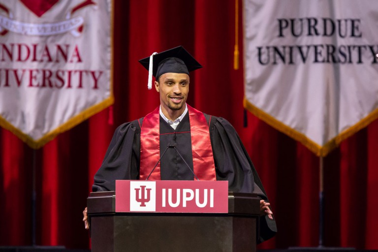 NBA guard George Hill speaks at commencement.