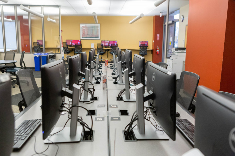 two rows of computer stations in a computer lab