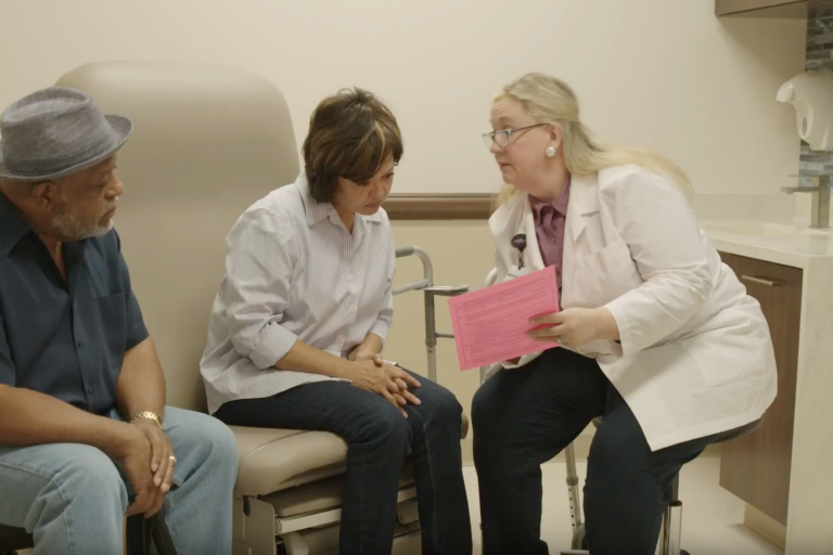 A nurse practitioner discusses medical care options with a couple