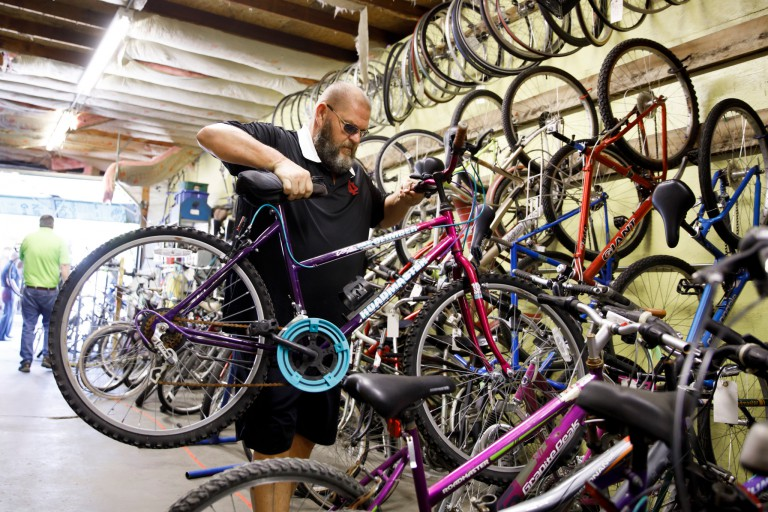 IU Surplus manager Todd Reid unloads a bicycle