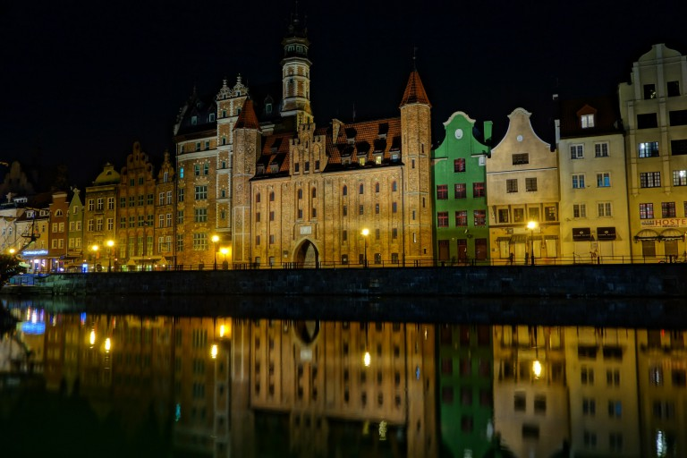 Old town section of Gdansk, Poland, reflected in the water at night.