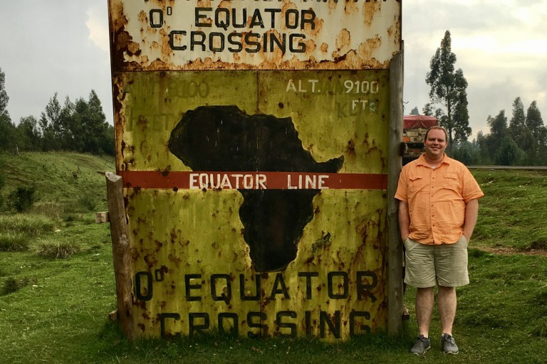 Neil Flick stands at the equator.