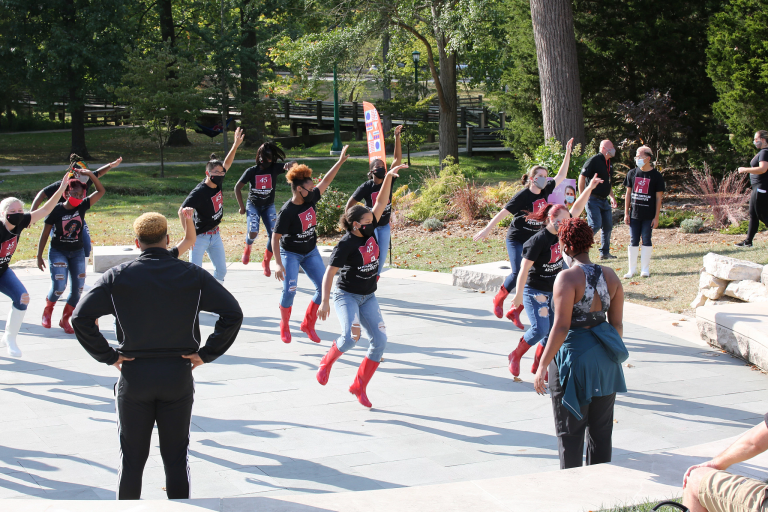 Members of the African American Dance Company rehearse outside