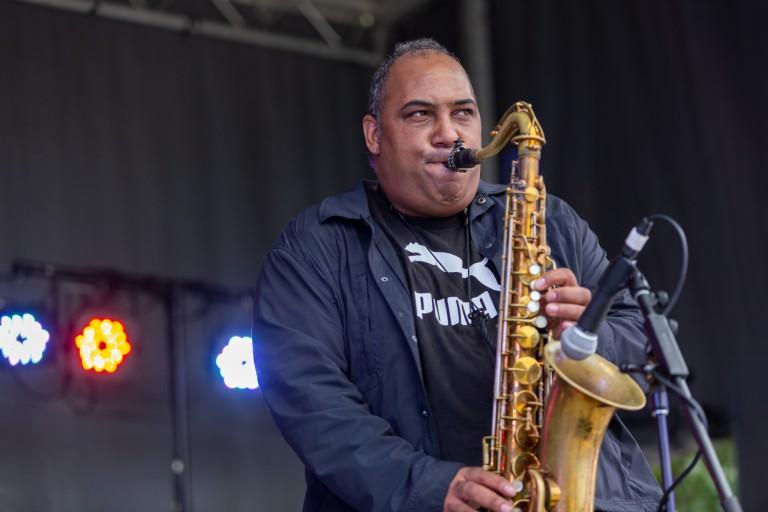 Rob Dixon blows his saxophone.