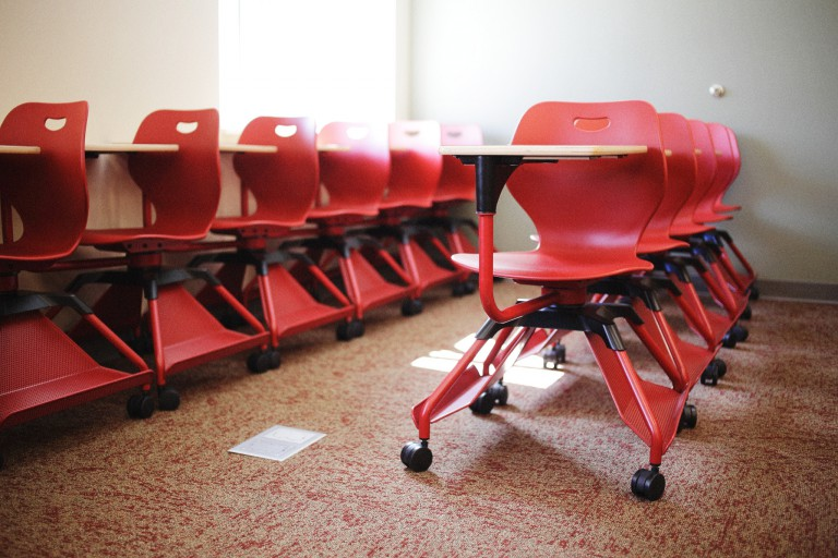 Red chairs in a classroom