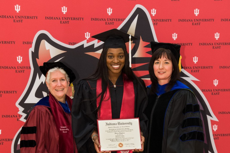 Chancellor Kathy Cruz-Uribe and Michelle Malott present Sloane Stephens with her degree