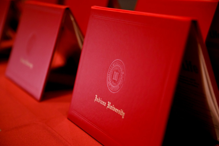 A row of red Indiana University diplomas