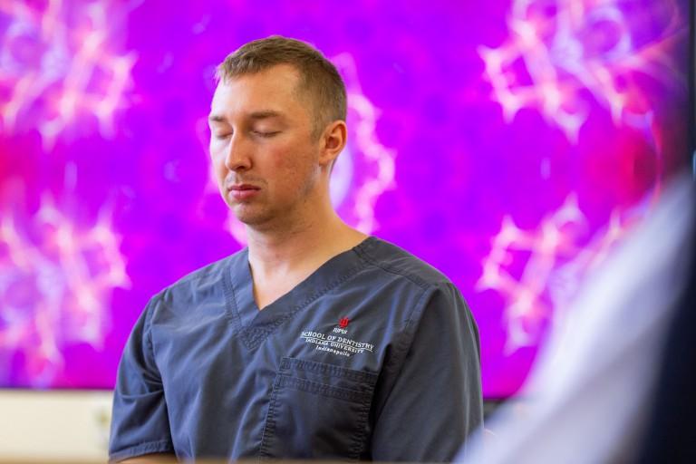 A dental student meditates.