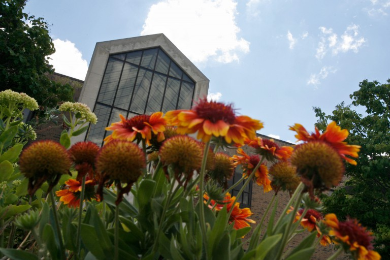 Flowers frame Hayes Hall on the IU East campus.