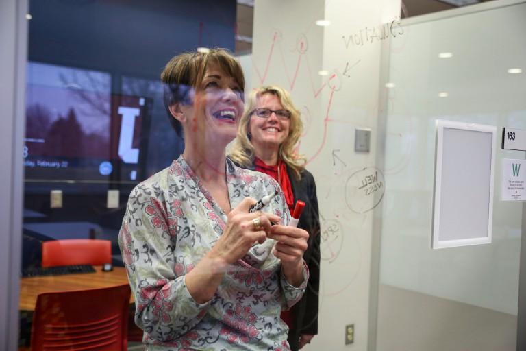 Cheryl Ferwerda and Melinda Stanley brainstorm ideas for a health care facility