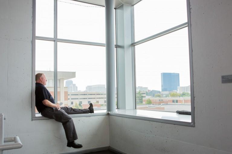 Campus Center director Joe Hayes sit in a quiet stairwell window.