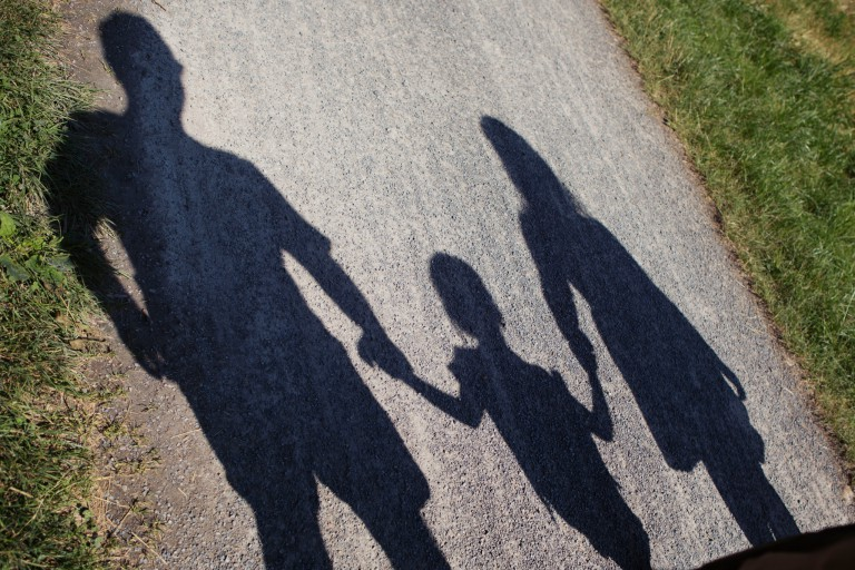 Silhouette of child with parents