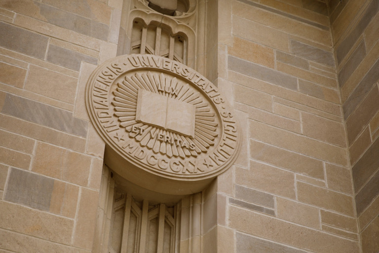 A limestone Indiana University Seal adorns the front of the Lilly Library