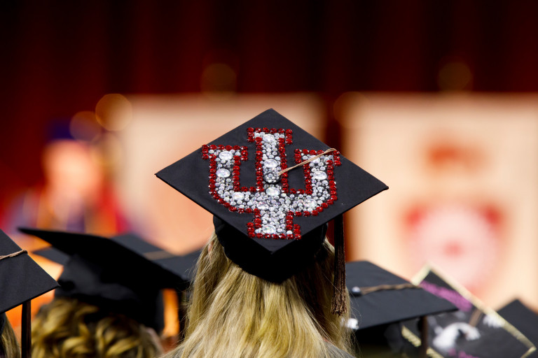 Sparkly IU trident on a mortarboard at commencement