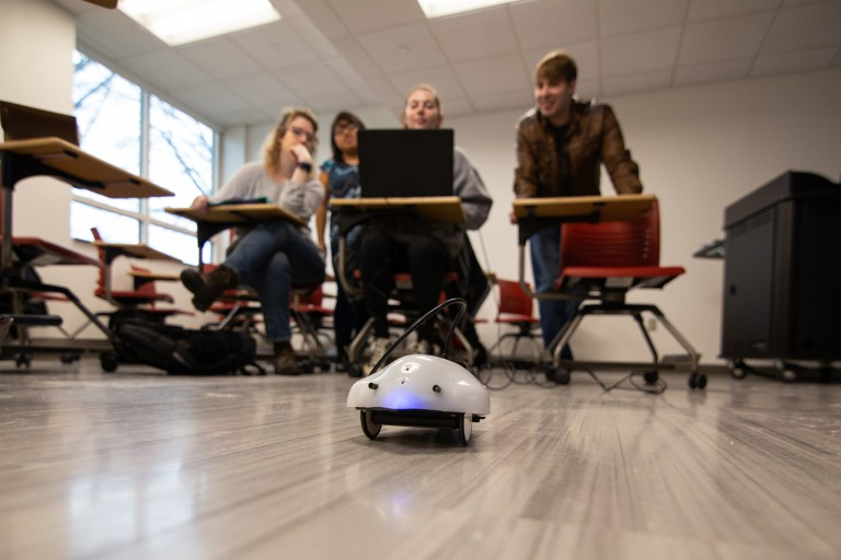 students using robot