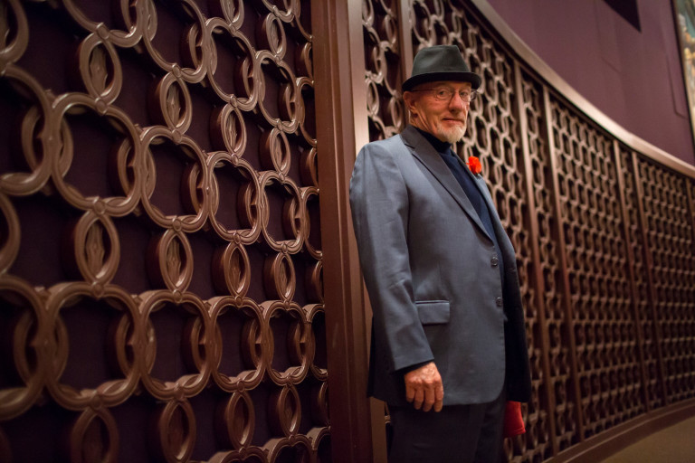 Actor Jonathan Banks stands near an ornate wall before being introduced for an IU Cinema event