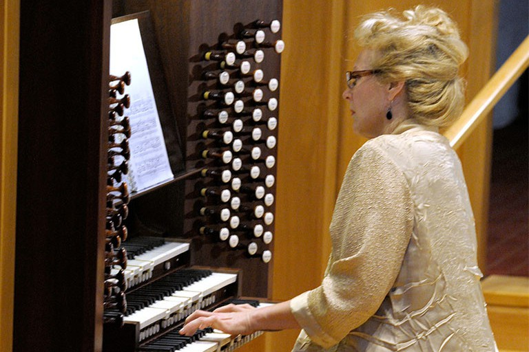 Janette Fishell plays the organ.