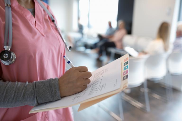 Nurse writes in patient's chart
