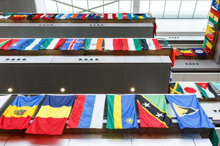 World flags hanging from the balconies in the IUPUI Campus Center
