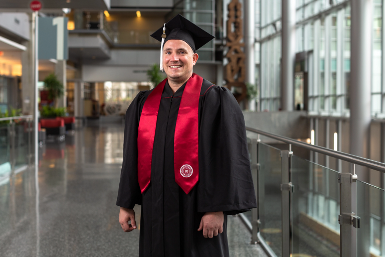Matthew Brown wears his IUPUI commencement cap and gown