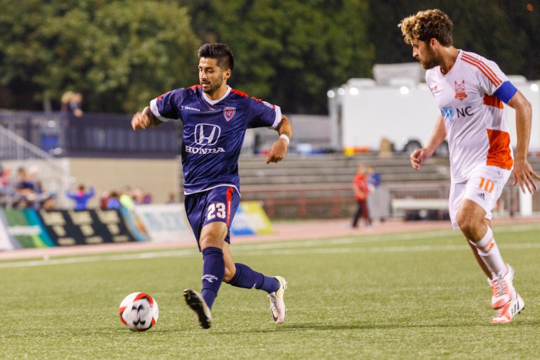 Indy Eleven player dribbles the ball.