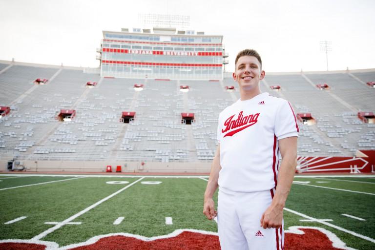 Matt Coffman in his cheerleading uniform at Memorial Stadium