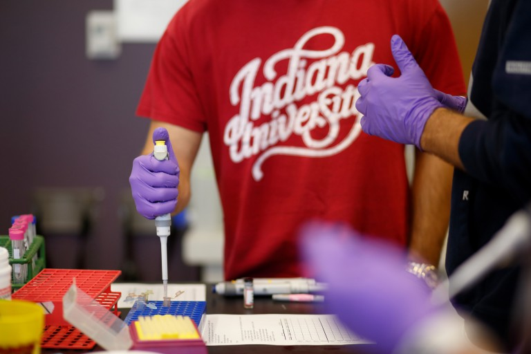 IU students conduct research in a chemistry laboratory