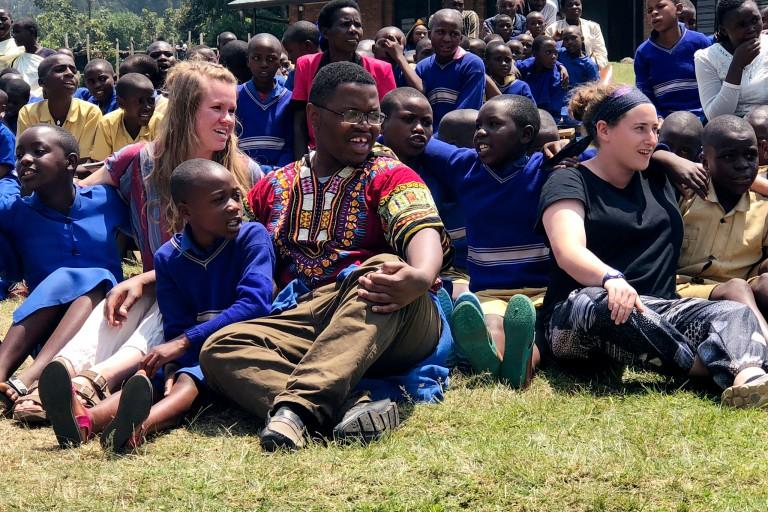 IU students sit with Rwandan students.