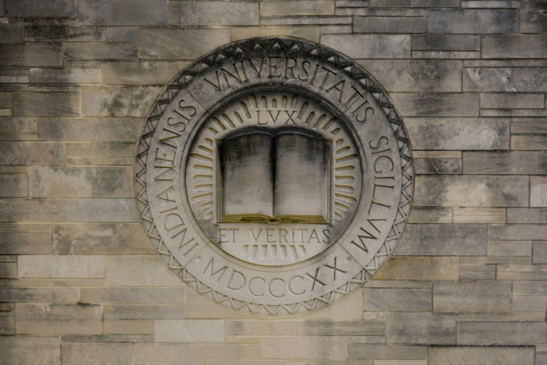 Indiana University's seal in the limestone of the Indiana Memorial Union