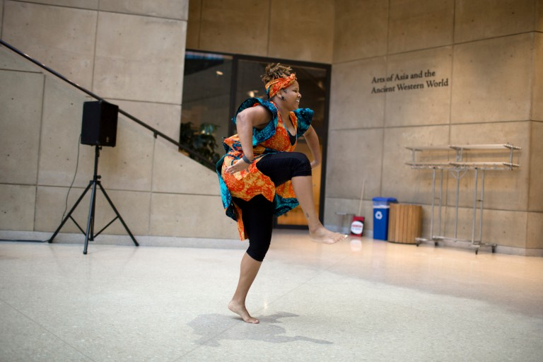 A woman performs traditional African dance at the Eskenazi Museum of Art