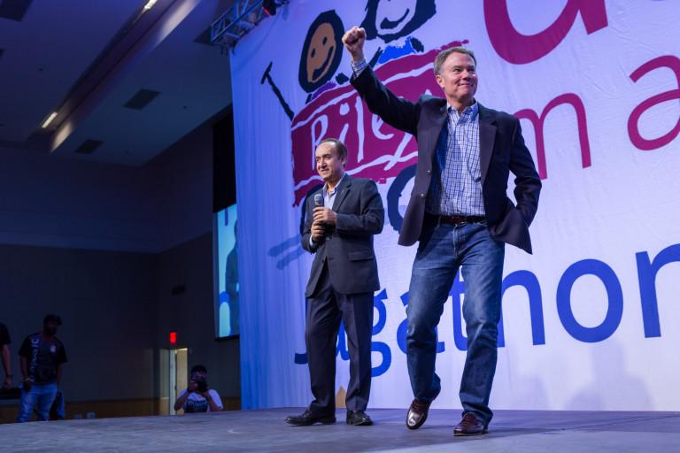 Indianapolis mayor Joe Hogsett standing on a stage