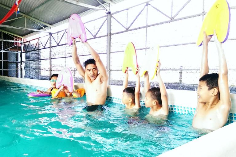 Children in Vietnam practicing swimming.