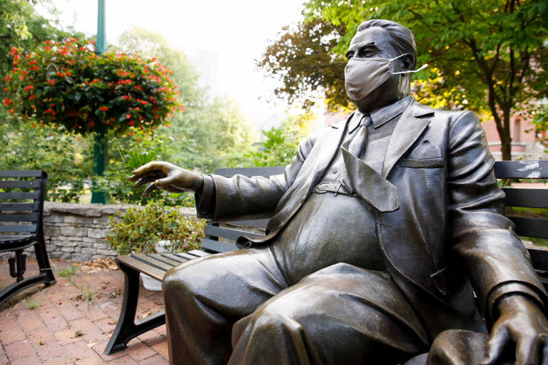 Herman Wells statue in an IU-branded mask