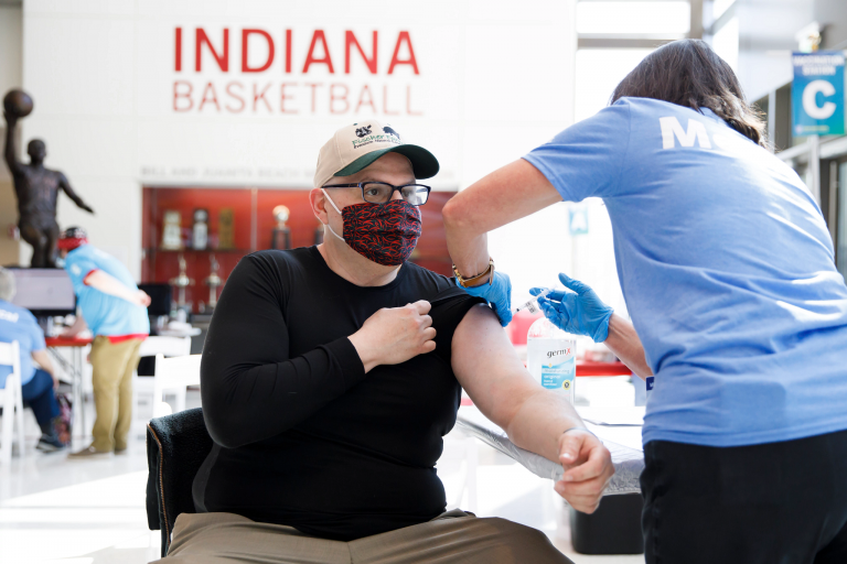 An IU staff member gets the COVID-19 vaccine at Assembly Hall in Bloomington