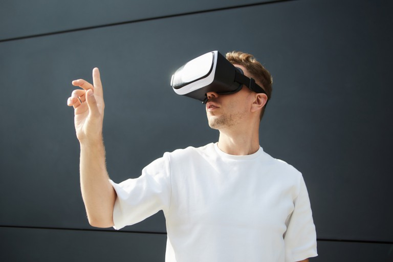 Virtual reality game player wearing a VR headset