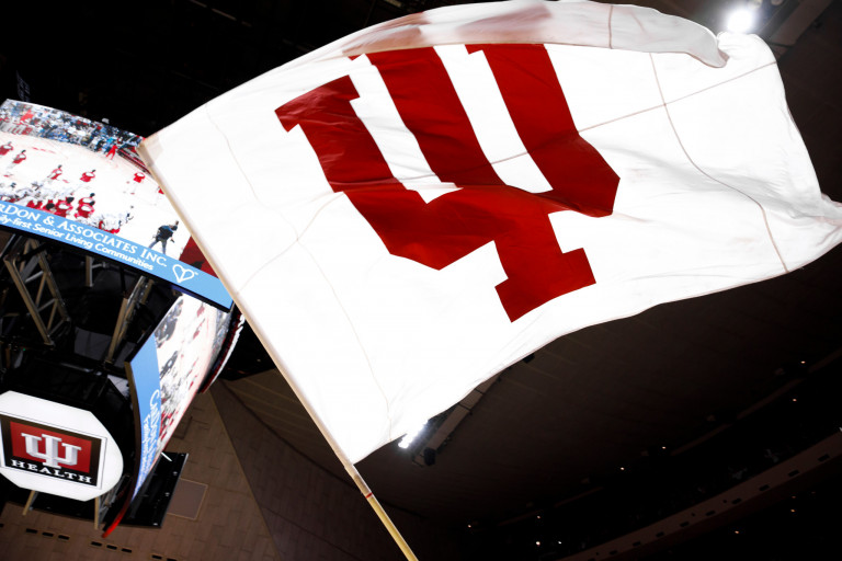 An IU flag is waved at Assembly Hall