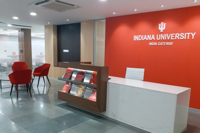Lobby area with chairs and a desk in the IU India Gateway office