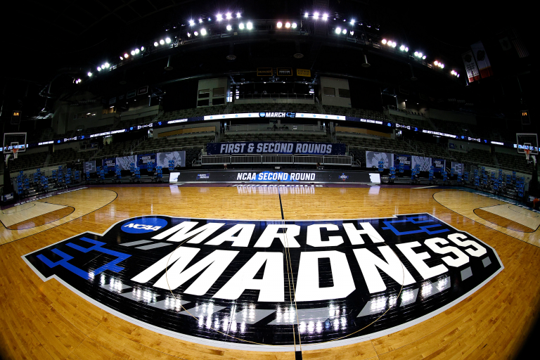 a wide-angle view of the NCAA basketball court
