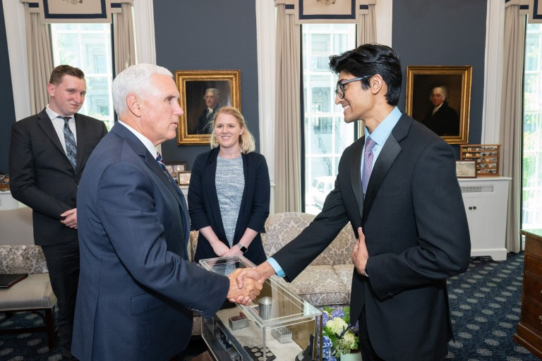 Mike Pence shakes hands with Ebin Daniel.
