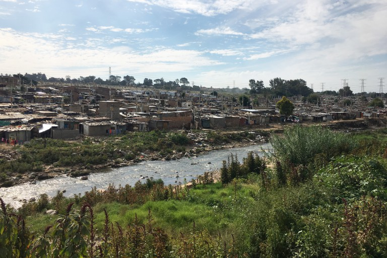 Slum of Johannesburg near a stream