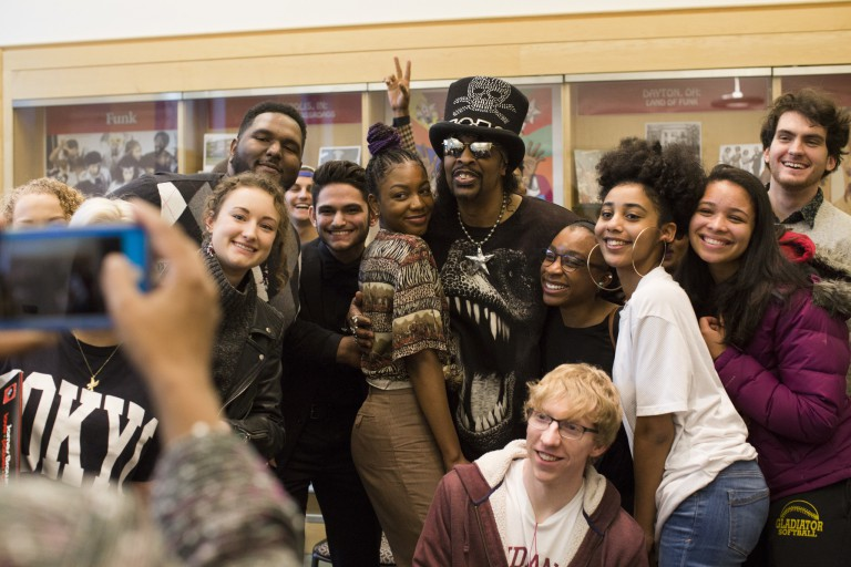 Bootsy Collins poses with students