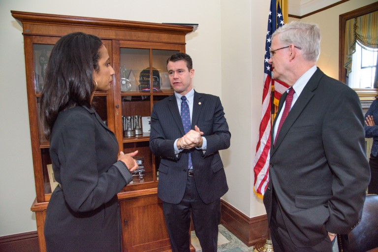 Una Osili and Sen. Todd Young at a pre-hearing meeting.