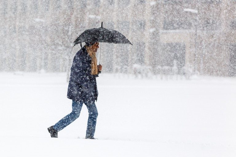 A student walks in heavy snow.