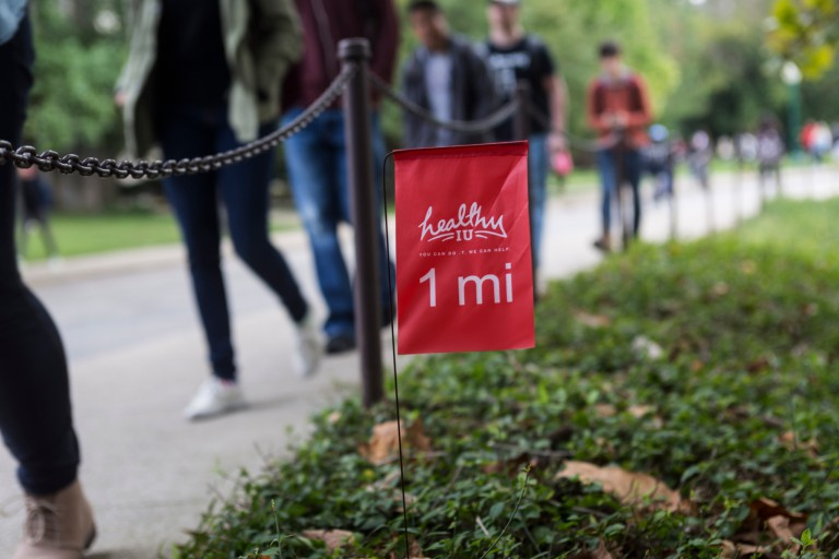 A 1-mile marker along a path on the IU Bloomington campus