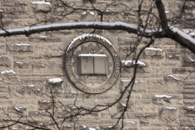 Limestone IU seal on the side of a building