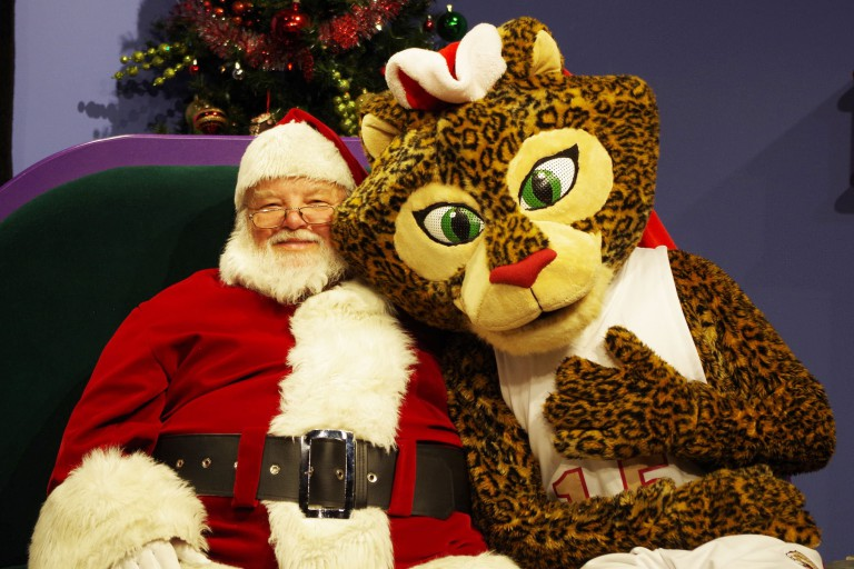 IUPUI's Jazzy the Jaguar mascot sits with Santa
