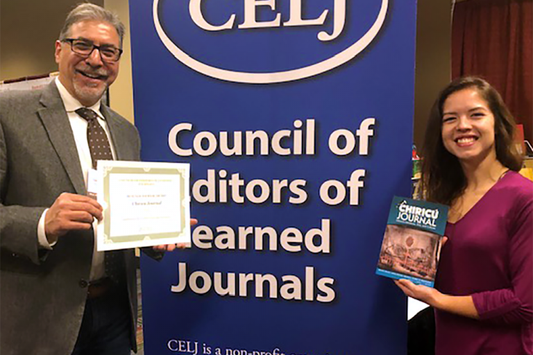 Representatives from Indiana University receive the award for Best New Journal