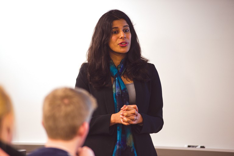 Shahzeen Attari lectures in a classroom