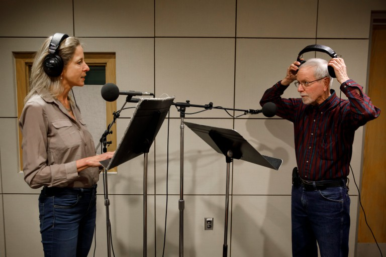 Yael Ksander, left, and Don Glass in front of microphones in the recording studio