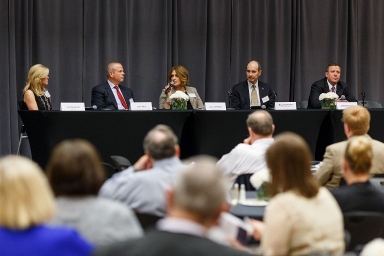 Jill Lehman speaks into the microphone during the panel session at the 3rd annual E2E Convergence.